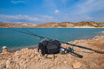 Fishing tackles lie on a shore of lake. Ready to fishing. Cyprus