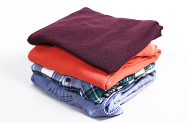 pile of bright folded clothes. White background