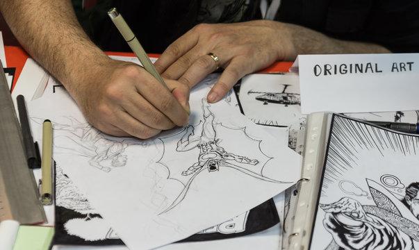 ATHENS, GREECE - April 16,2016: Exhibition Comics the artist draws a comic strip