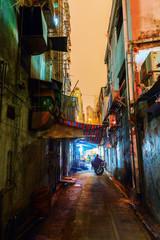 backstreet in Kowloon, Hong Kong, at night