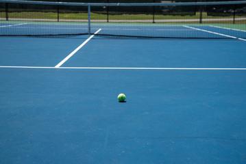 Tennis court and yellow tennis ball