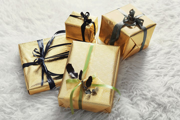 Set of different gift boxes on fur background
