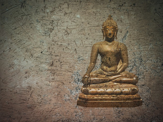 Golden buddha statue on brown crack earth