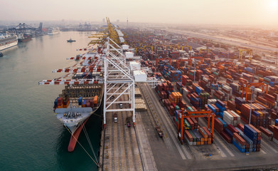 Fototapete - Ship for container with working crane bridge in shipyard for Logistic Import Export background