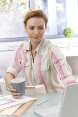 Young woman working in bright office