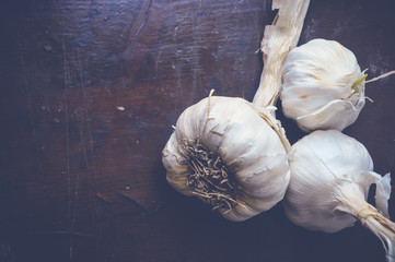 garlic on wooden table with copy space