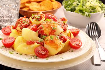 Lumaconi pasta with tomato sauce, bruschetta and salad