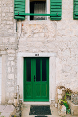 Green doors. Wood texture. Old shabby, irradiated paint. Old wooden doors