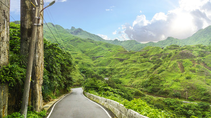 beautiful summer landscape green tree mountain transport road with cloud sky.