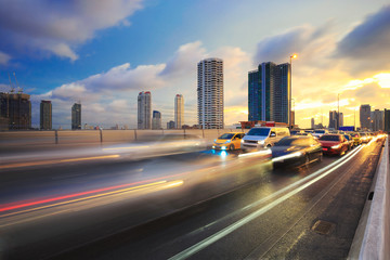 Evening traffic. The city lights. Motion blur, cars in highway with blur motion city background
