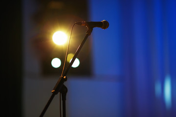 Microphone on the rack in the concert stage. Shallow depth of field. Selective focus.