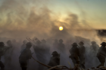 War Concept. Military silhouettes and tanks fighting scene on war fog sky background, World War Soldiers Silhouettes Below Cloudy Skyline At Dusk or Dawn. Attack scene