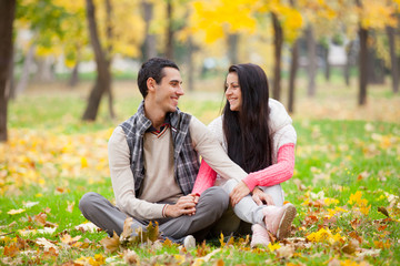 photo of cute couple hugging on the wonderful yellow trees background