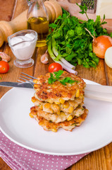 Chicken fritters with corn, onions and fresh herbs