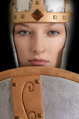 closeup female warrior with helmet and shield