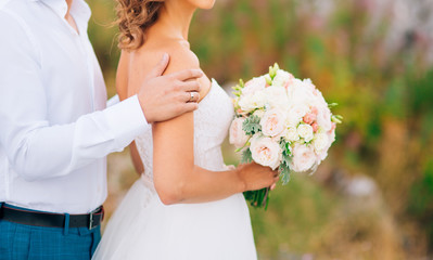 Wedding bridal bouquet of Lisianthus and Cineraria silver in the hands of the bride. Wedding in Montenegro.