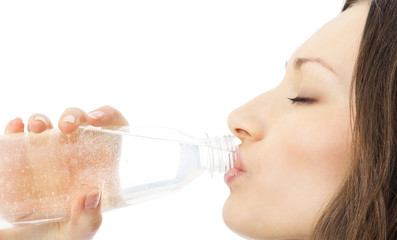 Woman in drinking water, isolated on white