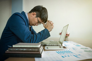 portrait of stressed business man with document graph in the office.