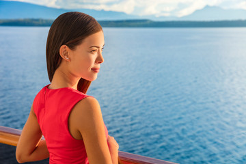 Wall Mural - Woman enjoying view of ocean horizon from luxury cruise balcony. Serene ship passenger relaxing outside on suite deck. European travel summer vacation destination.
