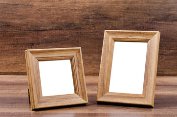 Wooden frame on wooden background.