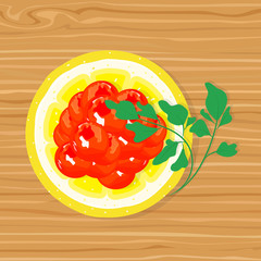 Delicious red caviar on the slice of lemon and parsley on a wooden texture
