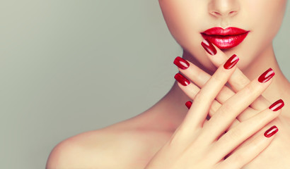 Foto op Plexiglas Manicure Beautiful girl showing red manicure nails . makeup and cosmetics