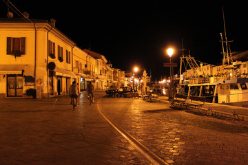 Italy. Emilia-romagna. Cesenatico. Street of town in the night sky background. Horizontal view.