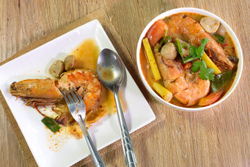 Prawn in white dish Tom yum kung in white bowl on wooden table