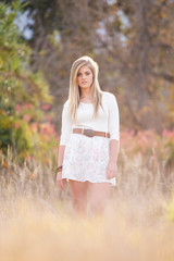 Beautiful teen model on a farm with an old house