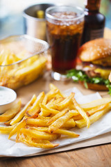 crispy french fries pile with hamburger for launch