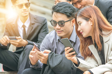Business-team working on smartphone at city background, Success business partners working at meeting, Smart life concept.