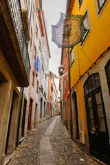 Fotobehang Smal steegje Narrow street of the Historic center of Coimbra, Portugal. World Heritage site by UNESCO since 2013