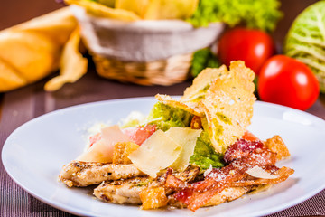 Caesar salad with bacon and chicken