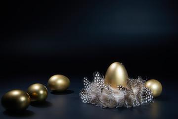 easter golden eggs on black background