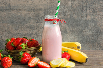 fresh strawberry and banana smoothie in a bottle