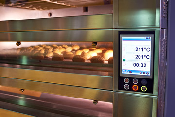 LCD screen of oven with bread in bakery