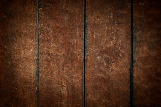 Old rural wooden wall in dark brown colors, detailed plank photo texture. Natural wooden building structure background.