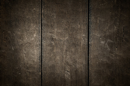 Old rural wooden wall in dark and black colors, detailed plank photo texture. Natural wooden building structure background.