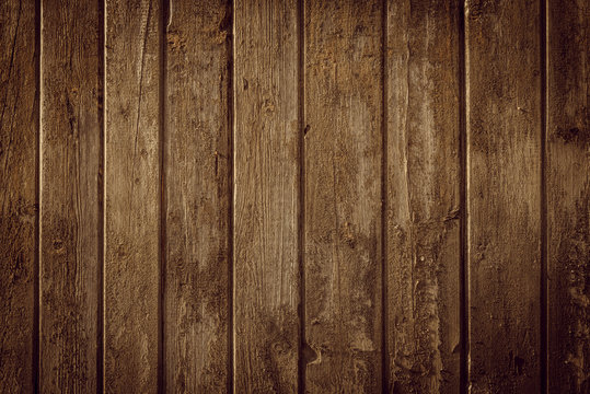Old rural wooden wall in warm brown colors, detailed plank photo texture. Natural wooden building structure background.