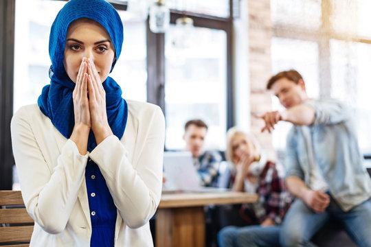 Muslim woman feeling humiliated