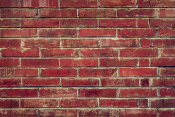 Old red brick wall with cracks and scratches. Horizontal wide brickwall background. Distressed wall...