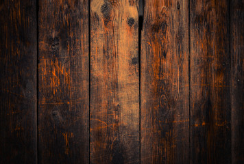 Old rural wooden wall in dark brown and orange colors, detailed plank photo texture. Natural wooden building structure background.