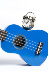 alarm clock and ukulele concept. Time to play.
