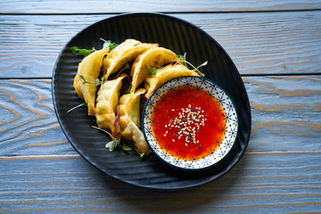 Steamed gyozas with teriyaki sauce