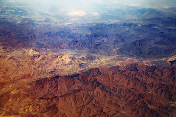 Aerial view from air plane of desert mountains