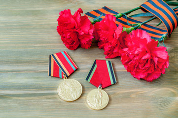 9 May composition - medals of Great patriotic war with red carnations and George ribbon