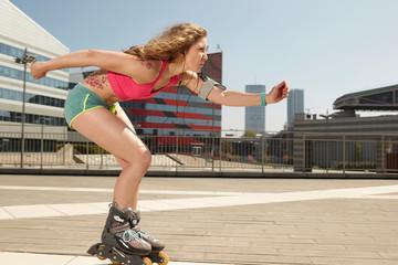 girl on roller skates in urban environment