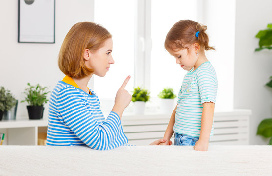 Mother scolds and punishes child daughter