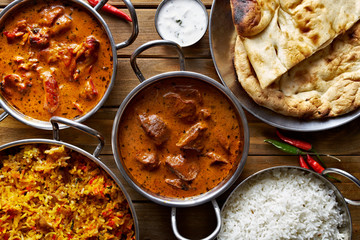 assorted indian curry and rice dishes shot from overhead composition Wall mural