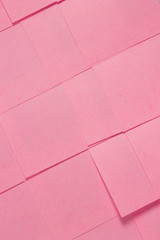 This is a photograph of Pink Sticky notes background